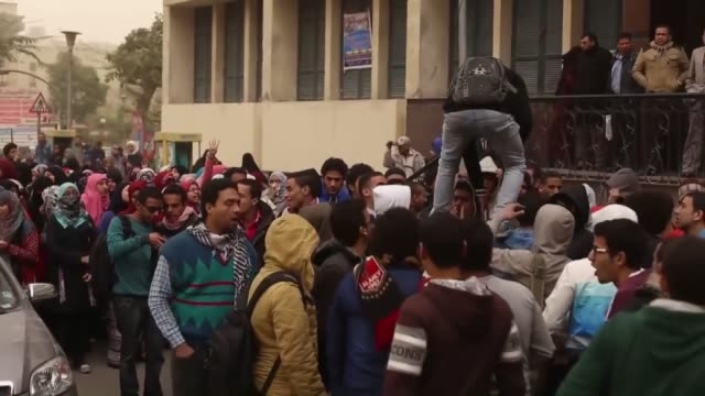 a group of egyptian students who call themselves as 'anticoup protestors' gather at the cairo university to hold a protest on the anniversary of... - president of egypt stock videos & royalty-free footage