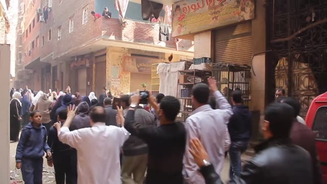 a group of egyptians stage a protest after an egyptian judge dismissed charges against former president hosni mubarak on last saturdayover the... - bearbeitetes segment stock-videos und b-roll-filmmaterial