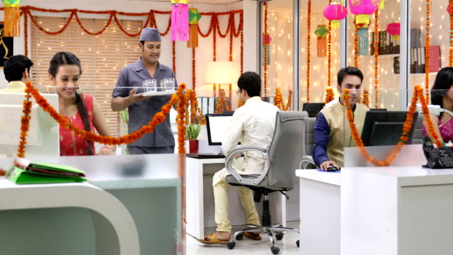 group of employees celebrating diwali festival with peon, delhi, india - 盆点の映像素材/bロール