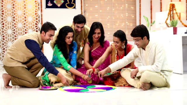 Group of employees decorating rangoli in the office, Delhi, India