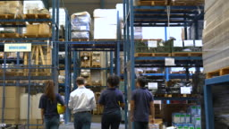 Group of employees walking in warehouse