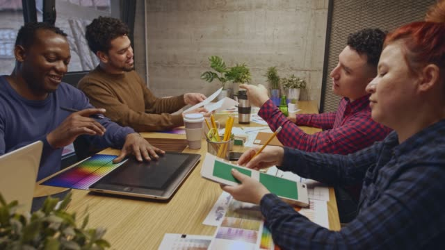 group of entrepreneurs reviewing plans and color swatches during a business meeting - color swatch stock videos & royalty-free footage