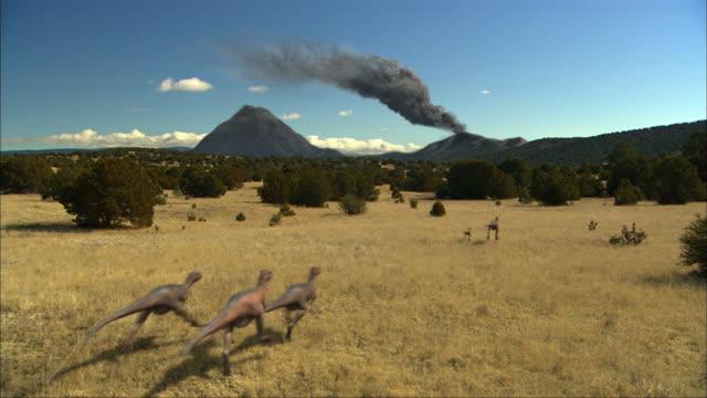cgi, ws, group of eoraptors running in field, rear view - eoraptor stock videos and b-roll footage