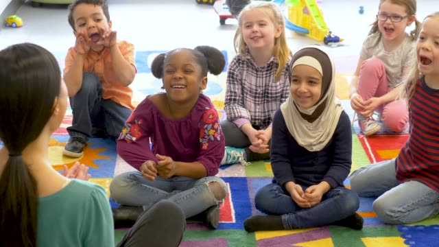 group of ethnic kids in daycare - elementary age stock videos & royalty-free footage