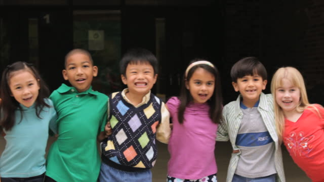 ms pan group of ethnically diverse children / richmond, virginia, united states    - arm around stock videos and b-roll footage