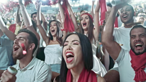 group of fans cheering for sports team - human arm stock videos & royalty-free footage
