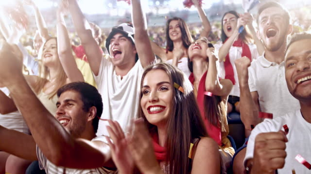group of fans cheering for sports team - american football sport stock videos & royalty-free footage