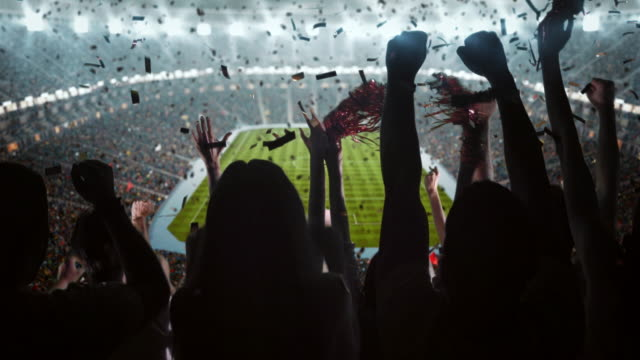 group of fans cheering for sports team - football stock videos & royalty-free footage