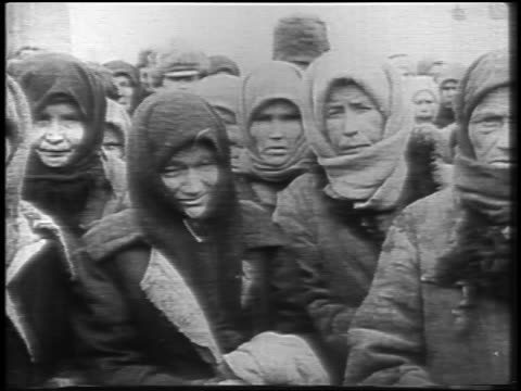 pan group of female famine victims in babushkas looking at camera outdoors / russia / news - 1921 stock videos & royalty-free footage