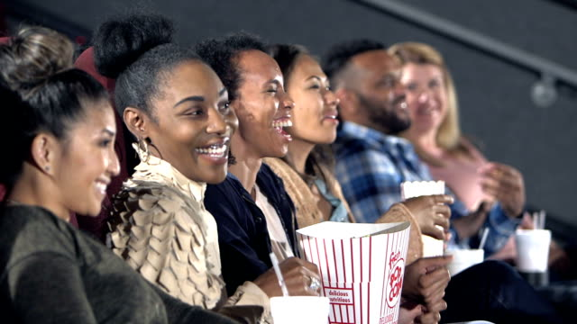 group of female friends enjoying movie together - cinema stock videos & royalty-free footage