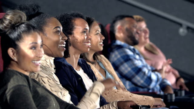 group of female friends enjoying movie together - audience stock videos & royalty-free footage