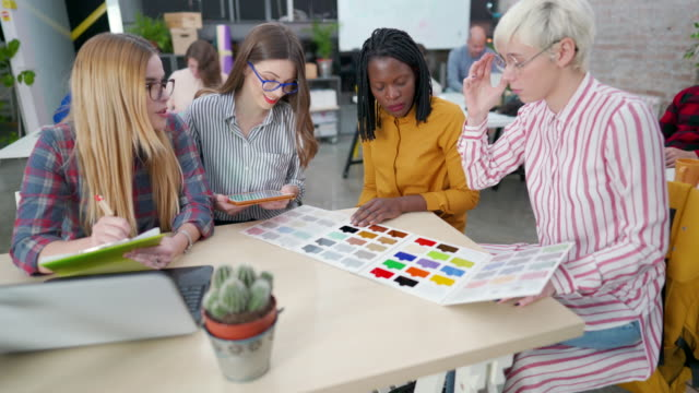 a group of female graphic designers working on color selection - color swatch stock videos & royalty-free footage