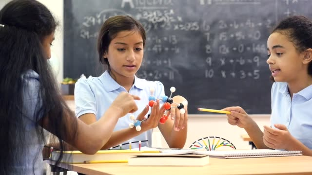 group of female junior high science lab partners discuss molecular structure - girls stock videos & royalty-free footage