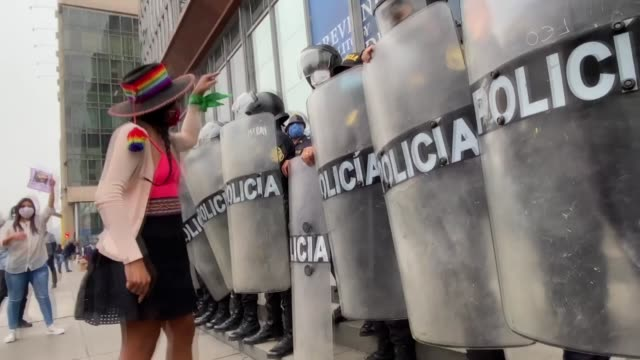 group of female protesters gathered outside the public ministry in peru's capital lima on saturday, june 20, in protest against femicide across the... - problems stock videos & royalty-free footage