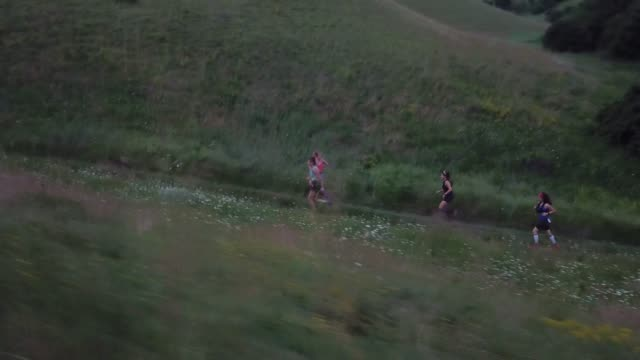 group of female runners racing in the nature - jogging stock videos & royalty-free footage