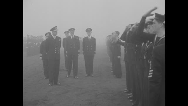 group of female spectators look on as british military review occurs in germany / philip duke of edinburgh reviews line of airmen and one airwoman he... - saluting stock videos & royalty-free footage