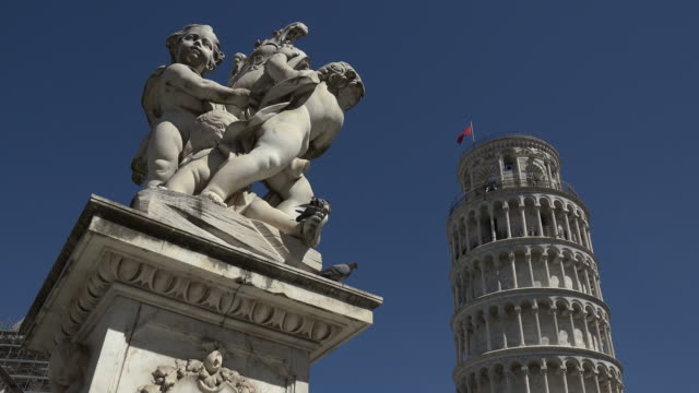 Group of Figures at Campo dei Miracoli with Leaning Tower, Pisa, Tuscany