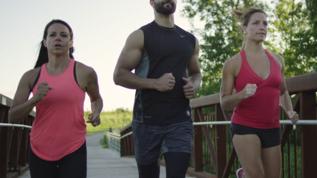 Group of fit runners running outside