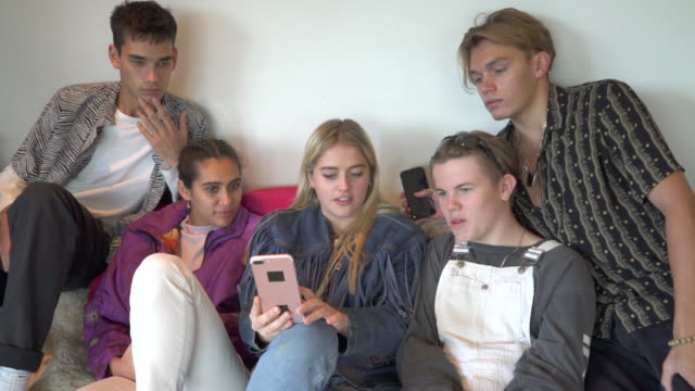 a group of five teenagers hanging out together. - dungarees stock videos and b-roll footage