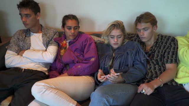 a group of five teenagers hanging out together. - eyes closed stock videos and b-roll footage