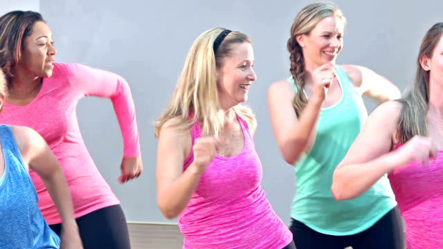 group of five women doing aerobics or dance routine - aerobics stock videos & royalty-free footage
