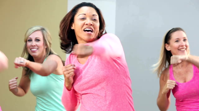 group of five women doing aerobics or dance routine - punching stock videos and b-roll footage