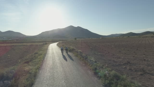 group of four cyclists in the roads near algueña village alicante provincespaineurope - cinematography stock videos & royalty-free footage