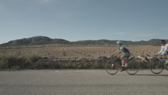 group of four cyclists in the roads near algueña village alicante provincespaineurope - 50 54 years stock videos & royalty-free footage