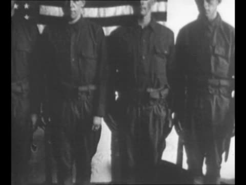 group of four men stand in undershirt-sleeves in new york city in 1917 / dissolve the men are clad in military uniforms, to indicate fitness for... - orthographic symbol stock videos & royalty-free footage