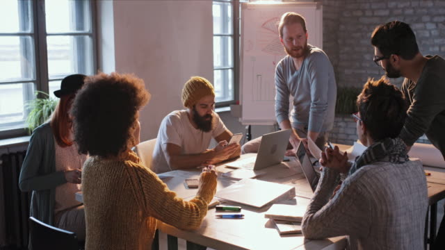 Group of freelancer workers talking about business project on a meeting at casual office.