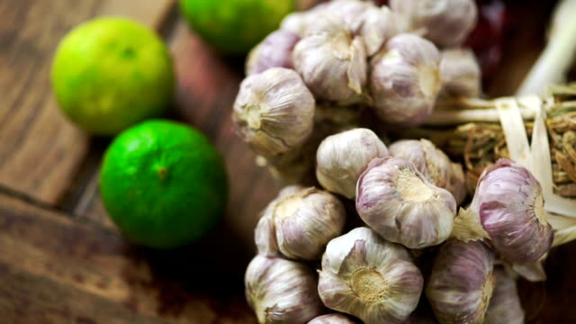 group of fresh garlic and limes on a wooden table. - ascorbic acid stock videos & royalty-free footage