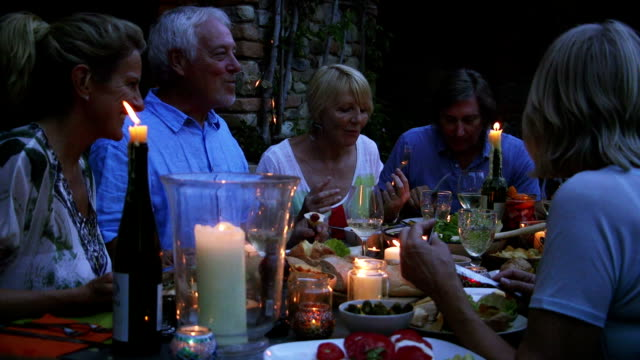 group of friends al fresco dining - tuscany stock videos and b-roll footage