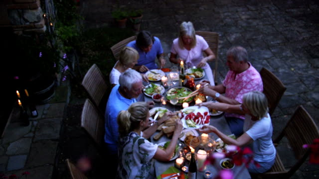group of friends al fresco dining - tuscany stock videos & royalty-free footage
