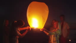 Group of Friends are Launching Sky Lantern