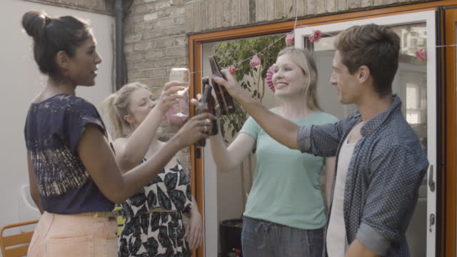 group of friends are making a toast in garden, outdoors. - four people stock videos & royalty-free footage