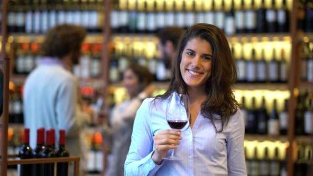group of friends at a wine tasting and then beautiful woman coming up to camera smelling and tasting the wine smiling - argentina stock videos & royalty-free footage