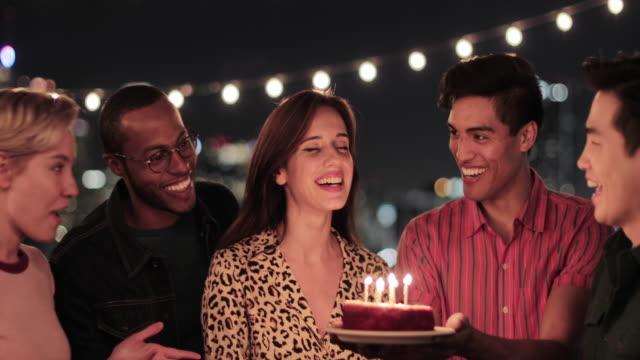 group of friends celebrating a birthday - kerze stock-videos und b-roll-filmmaterial