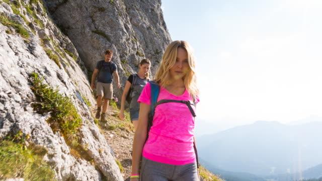 Group of friends climbing mountain, POV