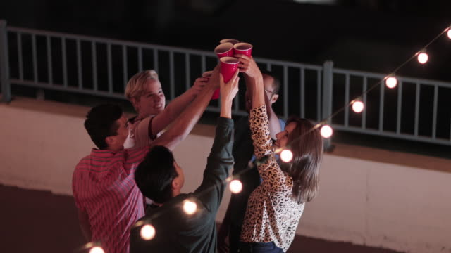 group of friends dancing at a rooftop party - patio video stock e b–roll