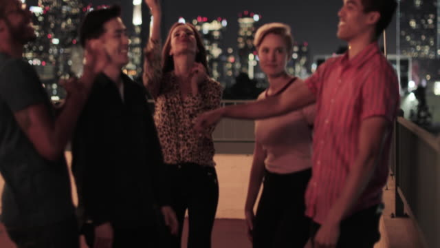 group of friends dancing at a rooftop party - patio stock videos & royalty-free footage