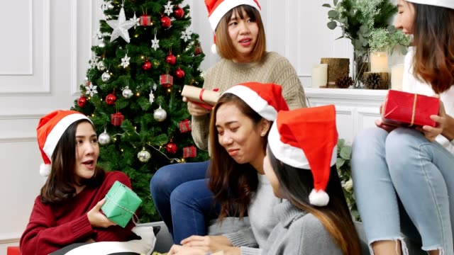 group of friends drinking alcohol in christmas party celebrate christmas festival. women enjoy festival. - christmas present stock videos and b-roll footage