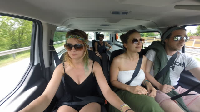 A group of friends drives through Europe with a camera recording close ups of themselves while driving.