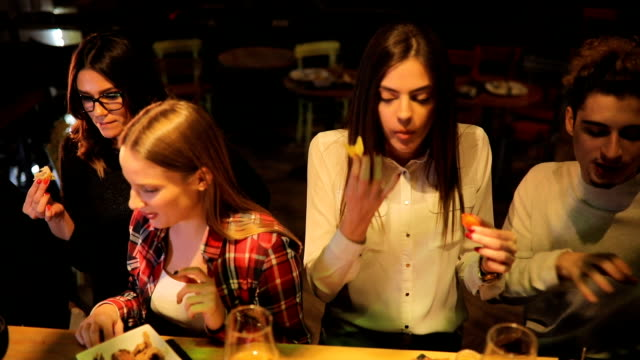group of friends eating at the bar counter - artisanal food and drink stock videos & royalty-free footage