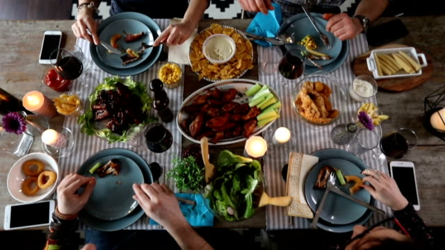 group of friends eating chicken wings , top view - dining table stock videos & royalty-free footage