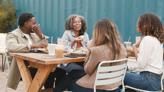 group of friends enjoy lunch on restaurant patio - outdoors stock videos & royalty-free footage
