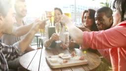 Group Of Friends Enjoying Drink In Bar