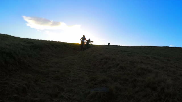 POV - Group of friends enjoying mountain biking.