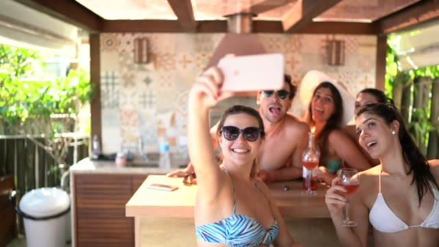 group of friends / family on vacation taking a selfie using smart phone at beach house - patio stock videos & royalty-free footage
