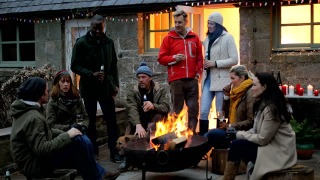 group of friends gathered around a fire pit - group of people stock videos & royalty-free footage