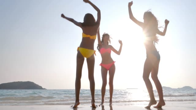 Group of friends girl having fun at summer on the beach.Girls dancing on the beach. summer holidays, travel, people and vacation concept.Vacations - iStock